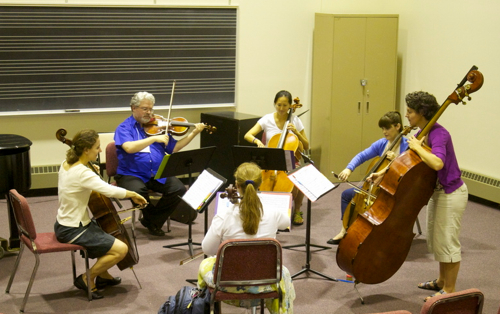 Stephanie Vial, left, working on continuo lines with violas and cellos at the Institute for Early Music on Modern Instruments. (Marion Meakem Photography)