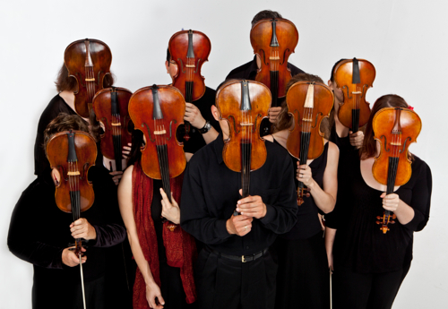 Tempestra strings stand behind their instruments. (Andy Kahl)