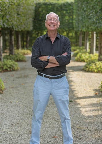 William Christie in the garden of his estate in Thiré, France. Photo by Jay Qin