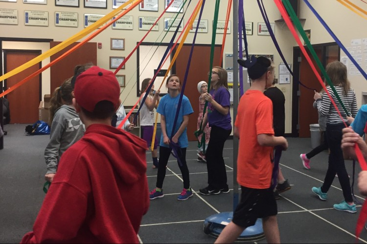 St. George Elementary students dance the maypole in rehearsal.