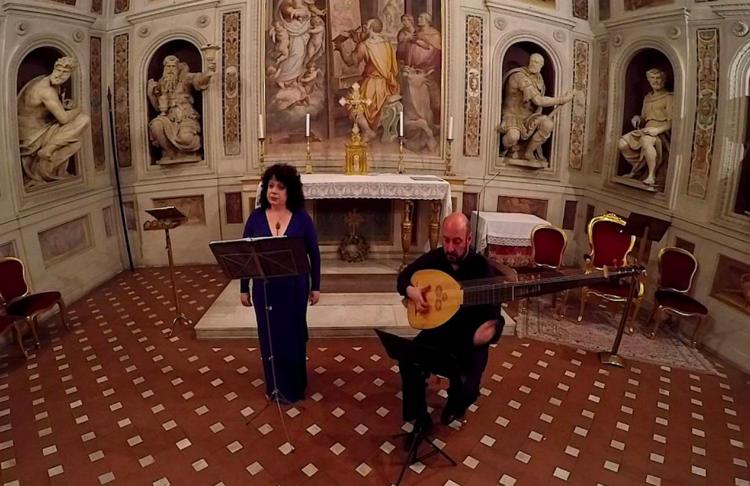 Soprano Jessica Gould and chitarrone player Diego Cantalupi at La Cappella di San Luca in Basilica della Santissima Annunziata in Florence, Italy.