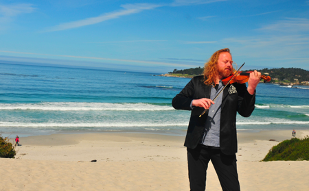 Violinist Edwin Huizinga on the beach. (Avery Gould)