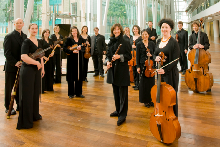 The Montreal-based Arion Baroque Orchestra is led by flutist Claire Guimond, center.