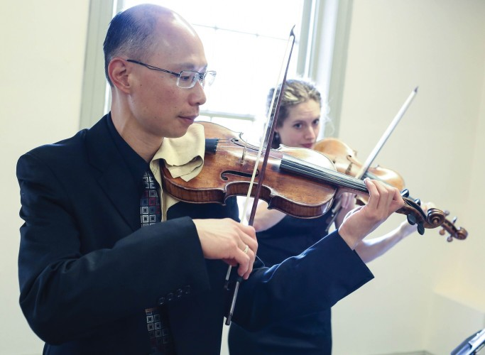 Tempesta di Mare concertmaster Emlyn Ngai and violinist Karina Schmitz. Photo by Mighty Engine