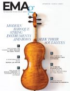 the back of a baroque violin on a while background with magazine contents listed